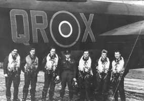 61 Sqn - photo of 7 aircrew members standing by the side of QR.X